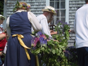 Midsommarstång (Midsummer pole) preparations at New Sweden, ME